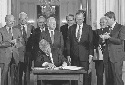President Bill Clinton signs the North American...
