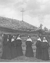 Catholic nuns gather in front of the St. Labre...