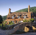 Typical Exmoor cottage by the double-arched...