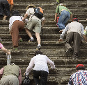 Tourists climbing the stairs to the upper level...