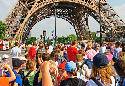Tourists queuing for a trip up the Eiffel Tower,...