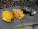 A comparison of caving helmets. Left: a...