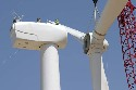 The photo shows a wind turbine during final...