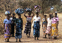 Women carrying bundles in Malawi, where 53...