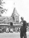 Walt Disney walking through the entance at...