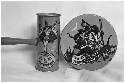 These two vintage Halloween noisemakers show two...