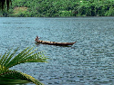 A traditional boat navigating the Volta River in...