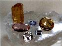 Selection of different colours and cuts of topaz....