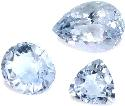 Three brilliant-cut aquamarine gems in a variety...
