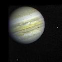 Io can be seen against the giant globe of Jupiter...