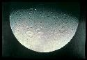 Dione is heavily cratered, like several other...
