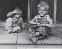 Depression era children playing with scrap...