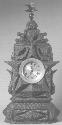 Tramp art clock. American; 1909. Carved and...