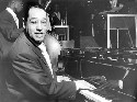 Jazz great Duke Ellington at the piano in Paris...