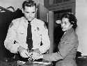 Rosa Parks being fingerprinted after her arrest...