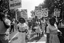 African Americans carrying signs for equal...