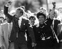 Nelson Mandela and wife Winnie, walking hand in...