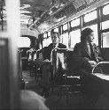 Rosa Parks sitting in the front of a bus in...