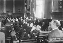 A jury listens to testimony in the 1913 trial of...