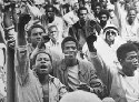 Attica prisoners give the Black Power salute on...