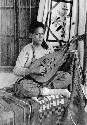 A Tunisan man plays an oud (ca. 1860), a...