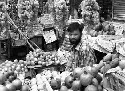 A fruit seller in Dhaka, Bangladesh. The...