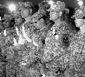 Soldiers attend a vigil for comrades killed in a...
