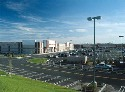 Urban sprawl's large parking lots and stores lead...