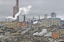 Pipes give off steam at Norilsk Nickel's copper...