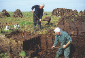 Men cutting peat from a bog in Maamturk Mountains...