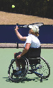 A wheelchair-bound athlete on the tennis court....