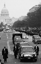 Flanked by Secret Service agents, President...