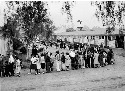 Evacuees of Japanese ancestry line up for lunch...
