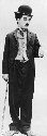 Charlie Chaplin in his classic hobo costume in...