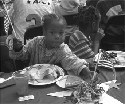 Children eating Thanksgiving dinner at the Los...