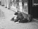 A homeless young man writing in his personal...