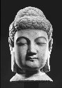 A white marble sculpture of the head of Buddha...