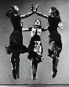 Three members of the Graham Company perform in...