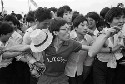 A man tries to hold back the crowd in Tiananmen...