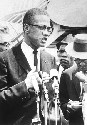 Malcolm X speaks at a press conference in...