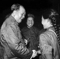 In September 1966, Chairman Mao greets a young...