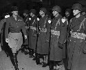 General Patton inspecting troops stationed in...