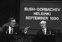 Presidents George Bush and Mikhail Gorbachev hold...