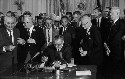 Lyndon Johnson signs the Civil Rights Act of...