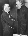 John Maynard Keynes (right) meets with Harry...