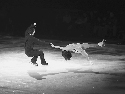 Professional figure skaters performing at a...