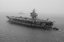 The nuclear-powered aircraft carrier USS...