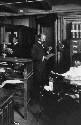 W. E. B. Du Bois at work at the offices of The...
