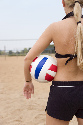Female beach volleyball athletes struggle with...