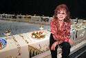 Judy Chicago pictured with her work, The Dinner...